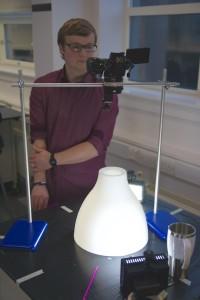 Joe observes soap bubbles on a prototype viewer