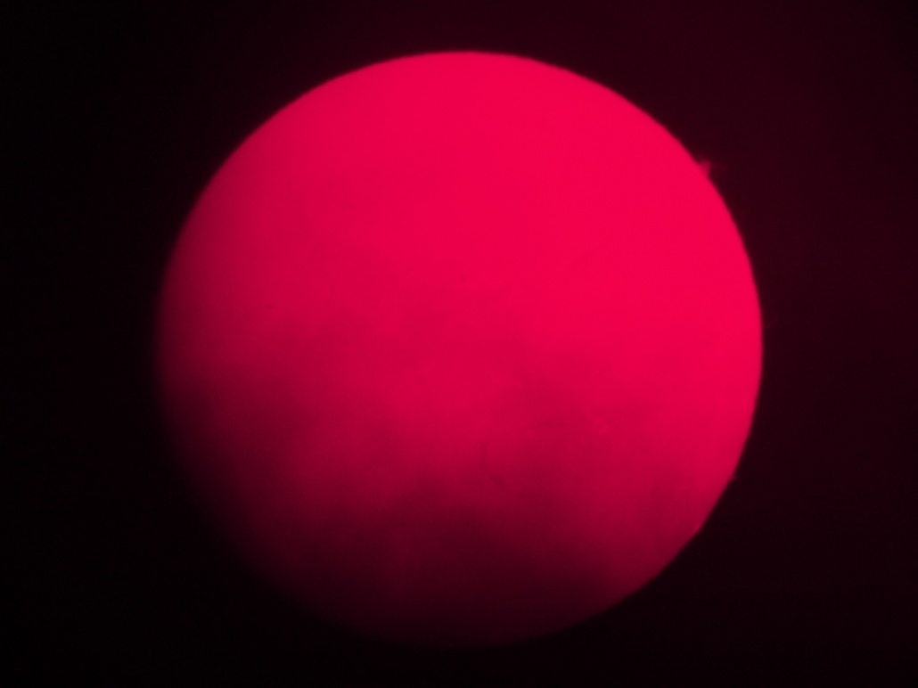 The sun's disc, with a little cloud, as seen through the solar telescope. December 11th 2014.