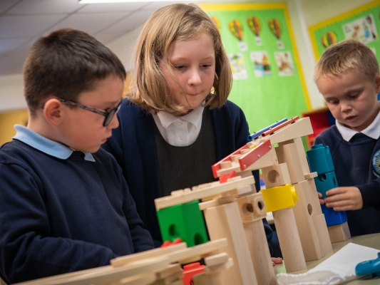Children looking at a marble run